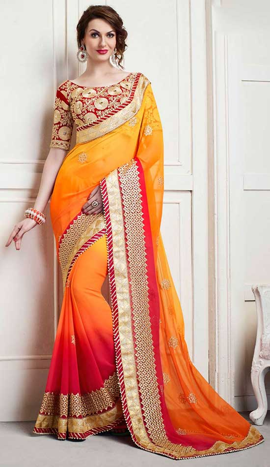 Shaded yellow wedding wear chiffon saree with boat designer blouse
