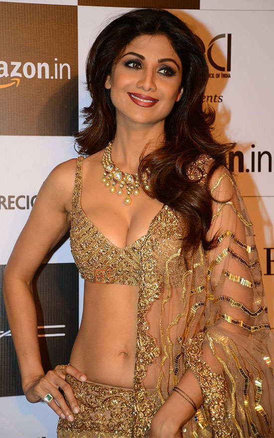 Shilpa Shetty In Gold color Saree
