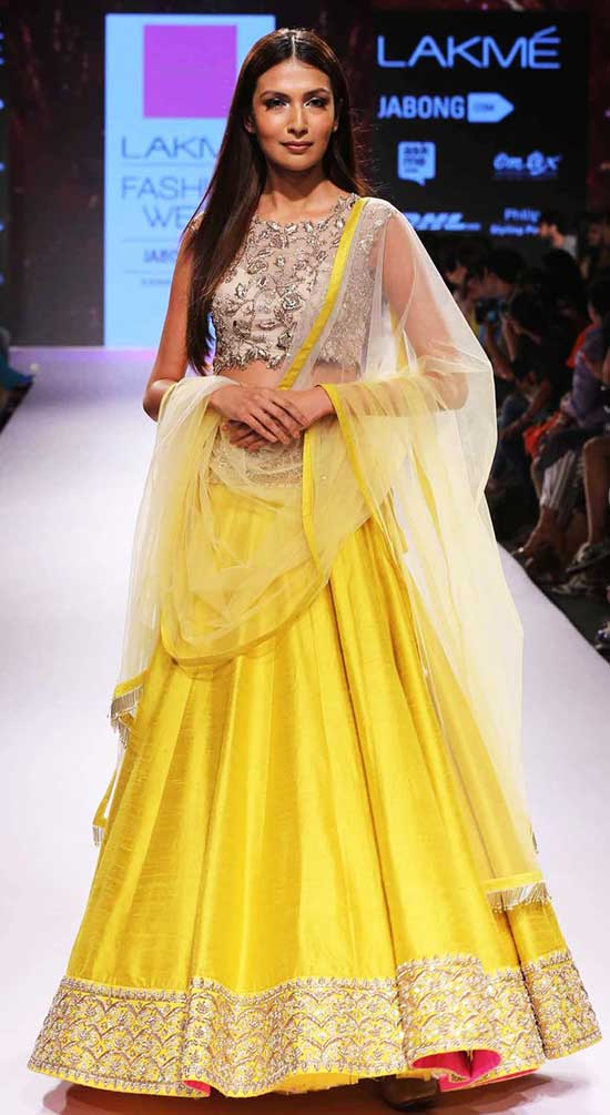 Simple And Sober Bright Yellow Designer Lehenga With Embroidered Blouse And Net Choli