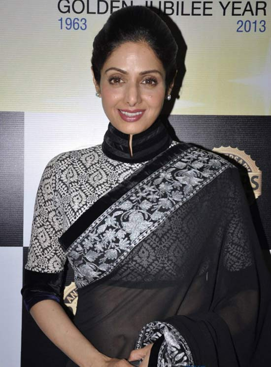 Sridevi opted for a high neck black and white embroidered saree