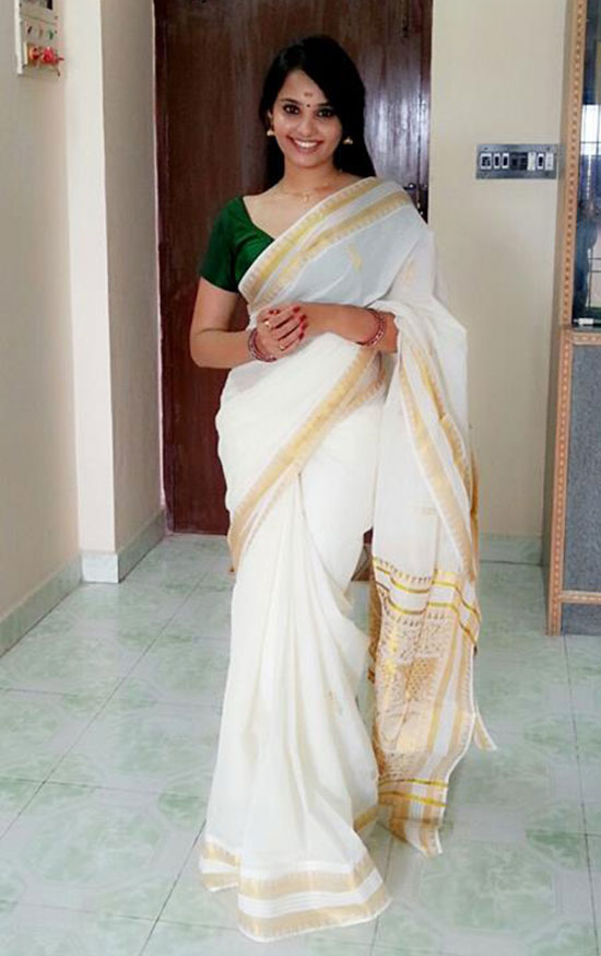 White Kerala Saree And Green Blouse