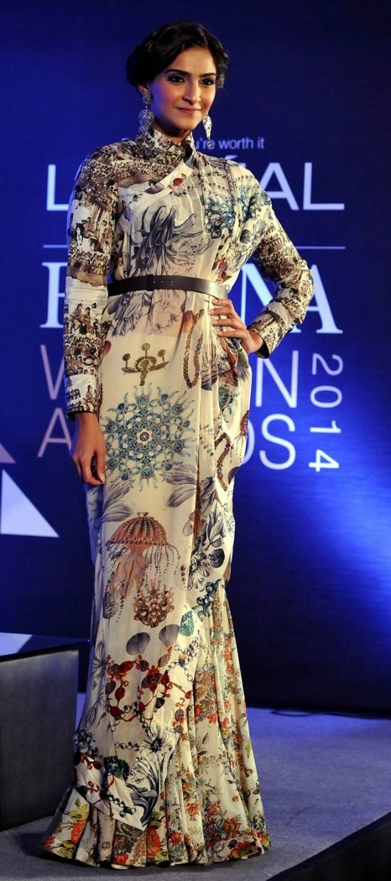 Sonam Kapoor In a Front Pallu Style and Put An Ethnic Belt Around Waist