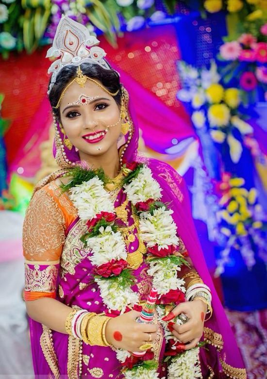 Bengali Bridal Wearing Purple Saree Paired With Embllished Blouse