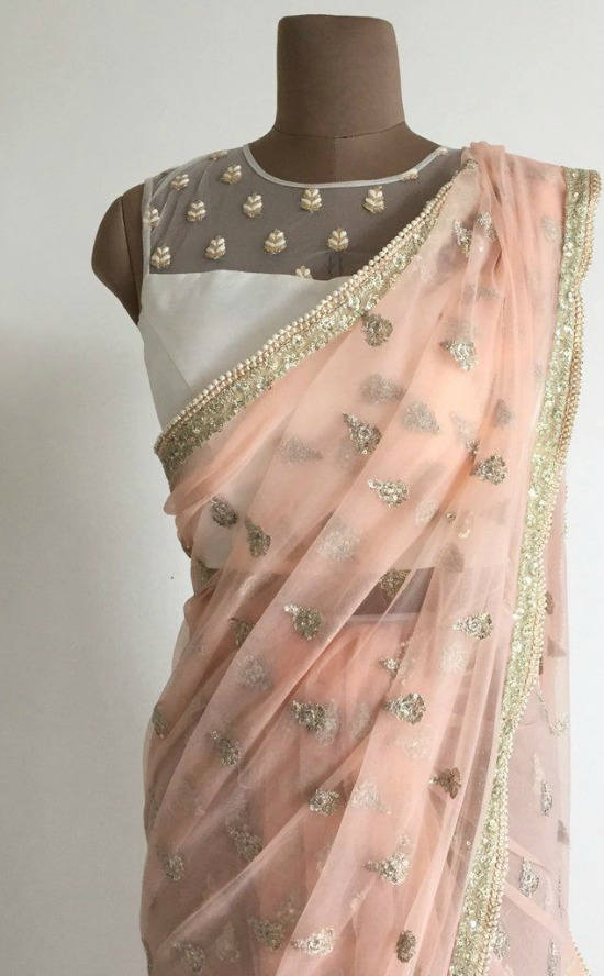 A Delicate Net Sari With Zari And Sequin Motifs All Over Complete With Pearls