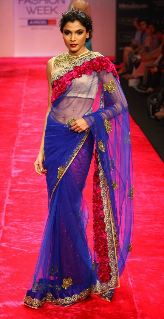 Blue Net Saree Paired With Jewel Blouse