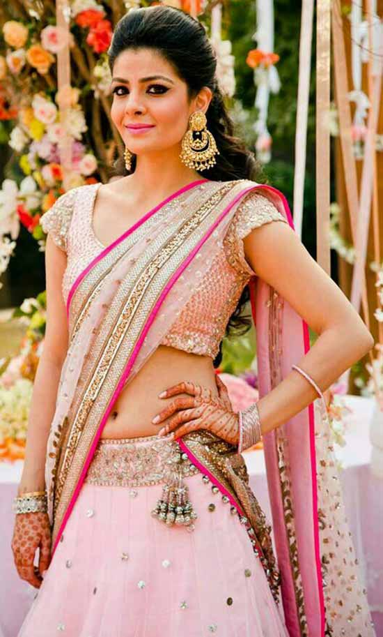 Indian bride wearing pink bridal half saree