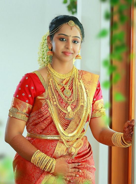 Kerala Bride Wearing Red Wedding Saree Paired With Sequins Work Blouse