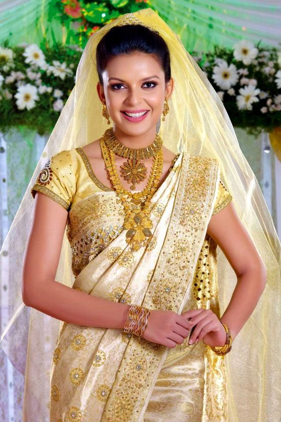 Kerala Christian Bride Wearing White and Gold Saree Paired With Kundan Work Blouse