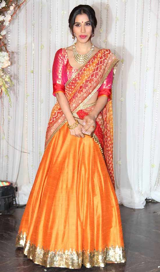 Orange and red Lehenga in raw silk