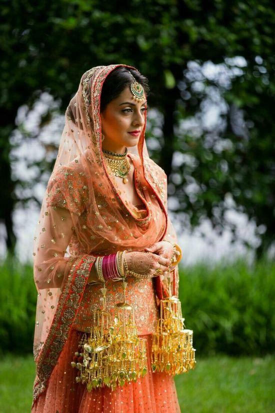 Panjabi Bride Wearing Lehenga With Long Blouse