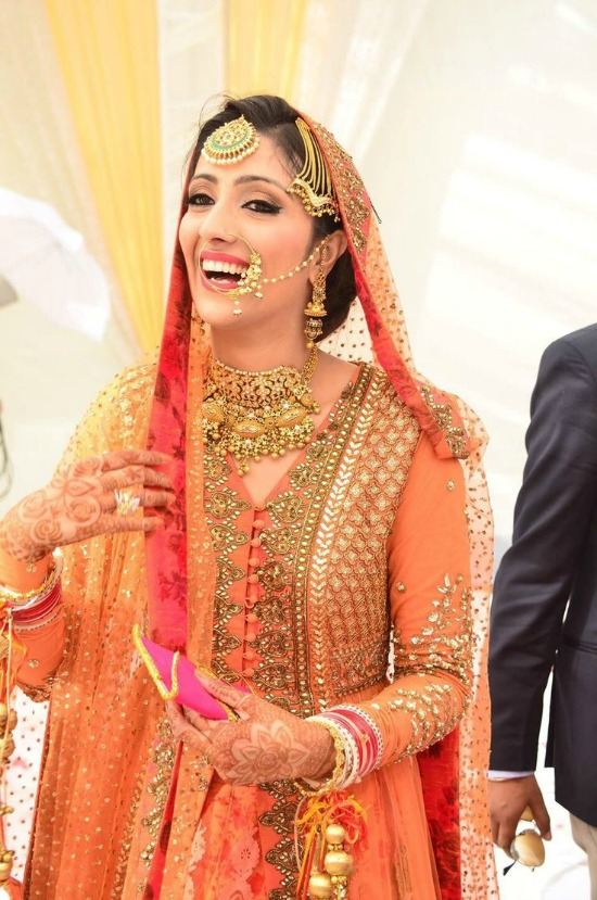 Sikh Bride Wearing Heavy Worked Orange Lenhenga