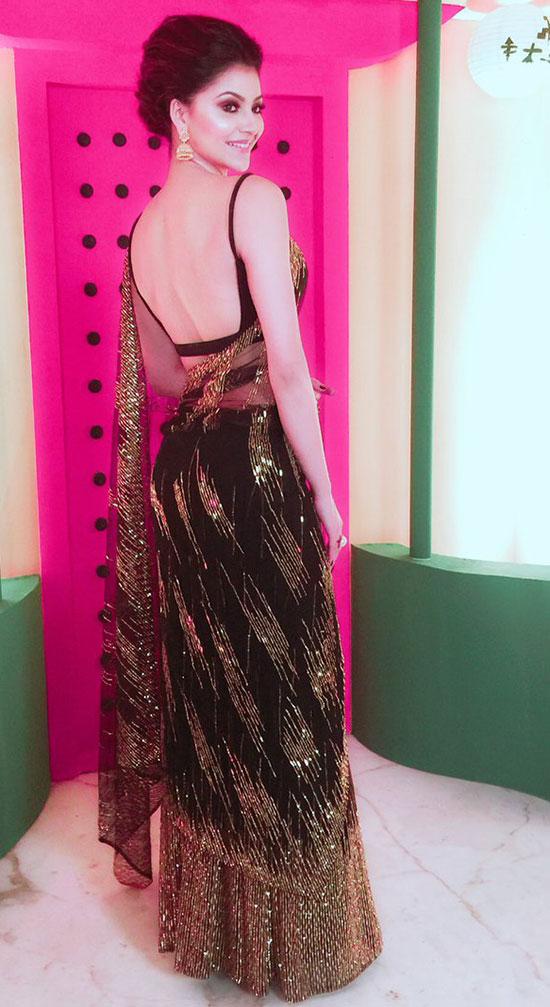 Urvashi Rautela In Black And Gold Net Saree