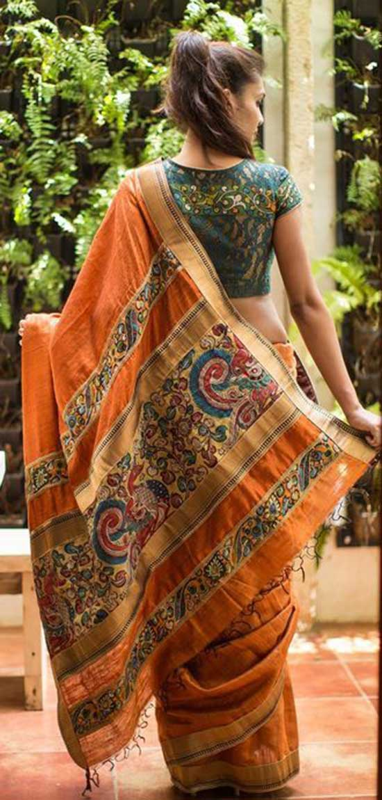 Orange with a surprise Kalamkari pallu