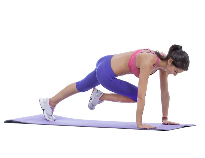 knee to elbow yoga pose for slim waist