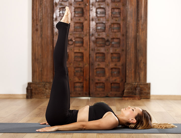 legs up the wall pose for adrenal fatigue