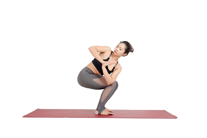 revolved chair pose for slim waist