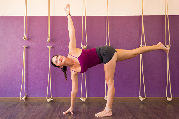 revolved half moon pose for slim waist
