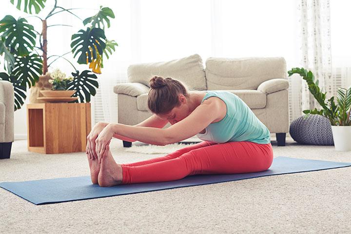seated forward fold to boost fertility
