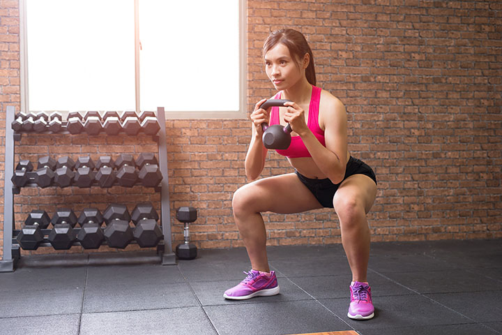squats with weights to tone legs