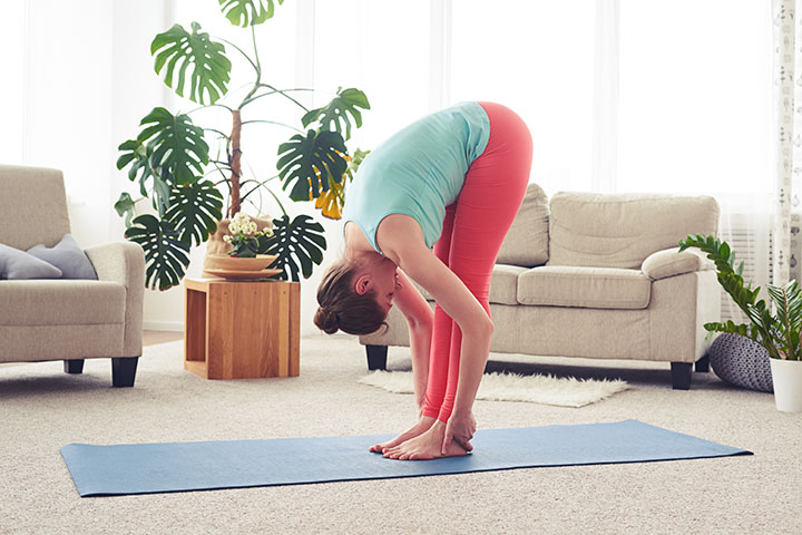 standing forward bend yoga to boost fertility