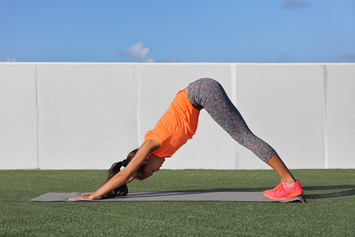 downward facing dog for flat stomach