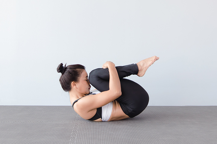knees to chest pose for menstrual cramps