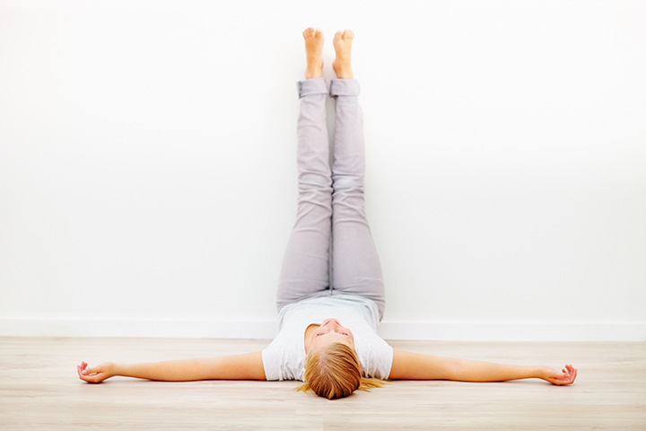 legs up the wall pose to combat fatigue