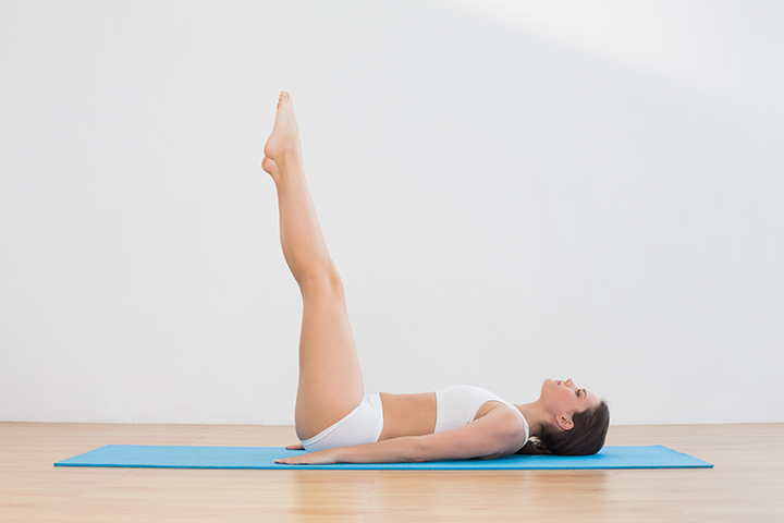 upward extended feet pose for scoliosis