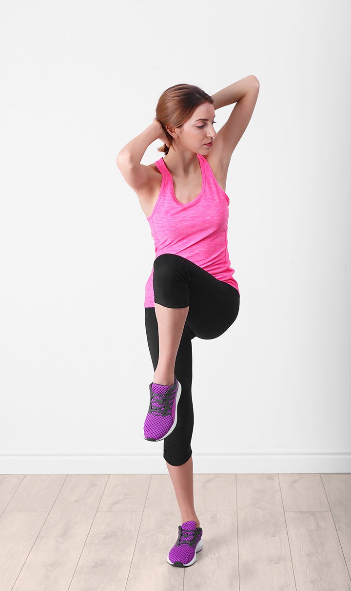standing bicycle crunch exercise