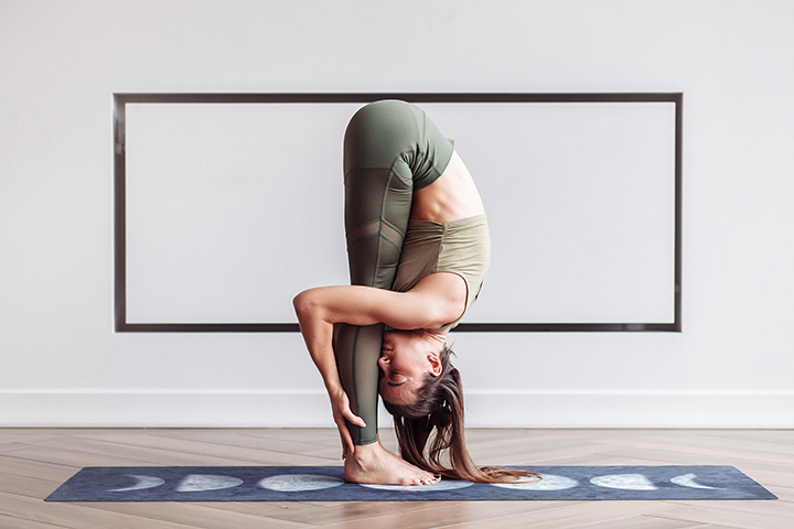 standing forward bend pose for back