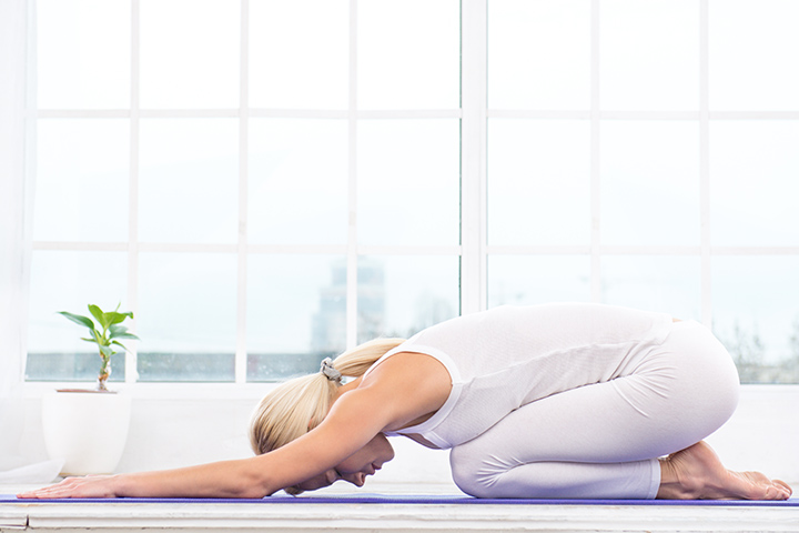 child's pose for hemorrhoid relief
