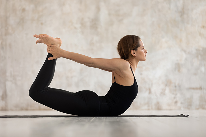 bow pose for flat stomach