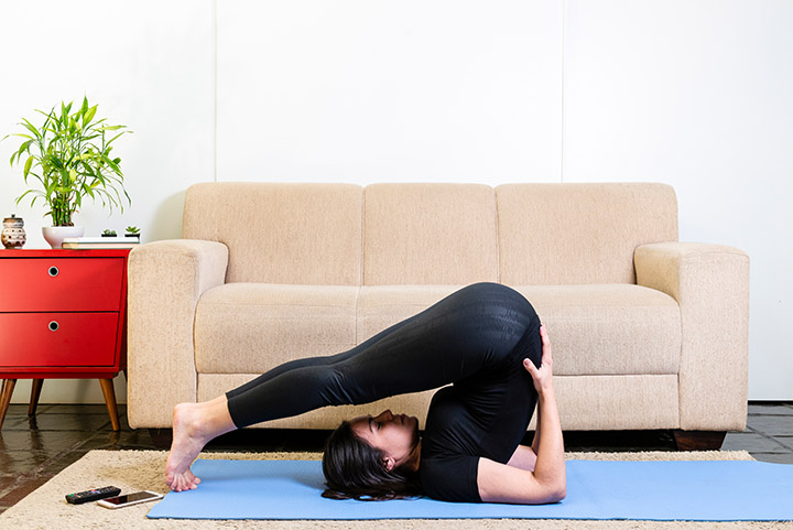 plow pose for bloating
