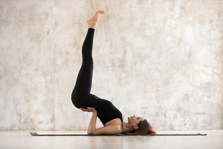 shoulder stand pose for flat stomach