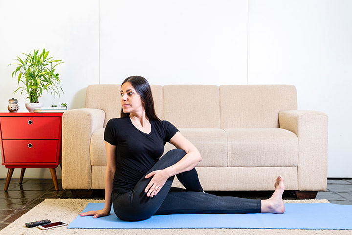 supine spinal twist pose for bloating